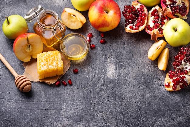Honig, apfel und granatapfel für rosh hashana Premium Fotos