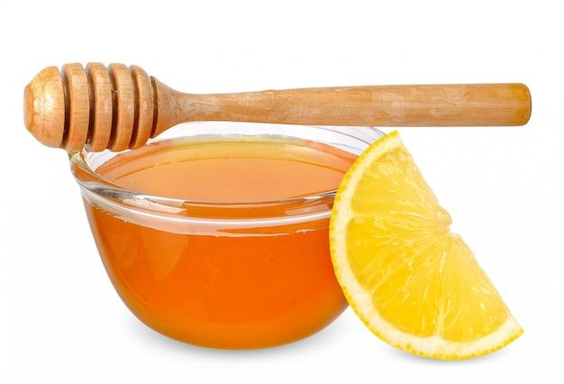 Honigzitrone lokalisiert auf weiß mit beschneidungspfad Premium Fotos