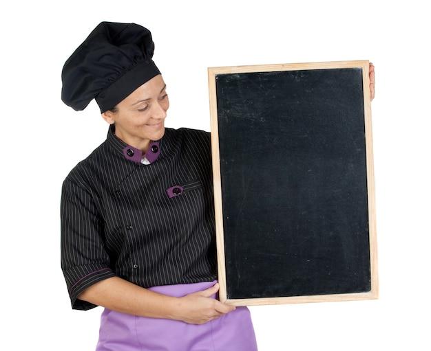 Hübsche kochfrau mit der tafel lokalisiert auf weißem hintergrund Premium Fotos