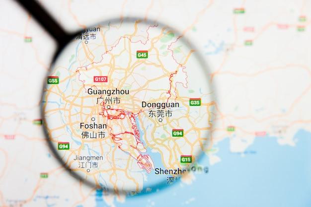 Illustratives konzept der stadtvisualisierung von guangzhou, china auf anzeigebildschirm durch lupe Premium Fotos