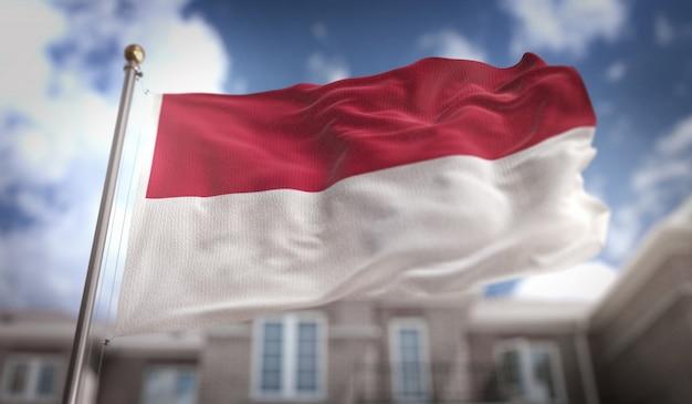 Indonesien flagge 3d rendering auf blauem himmel gebäude hintergrund Premium Fotos