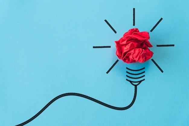 Inspiration und großes ideenkonzept auf blauem hintergrund. Premium Fotos