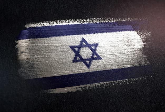 Israel-flagge gemacht von der metallischen bürsten-farbe auf dunkler wand des schmutzes Premium Fotos