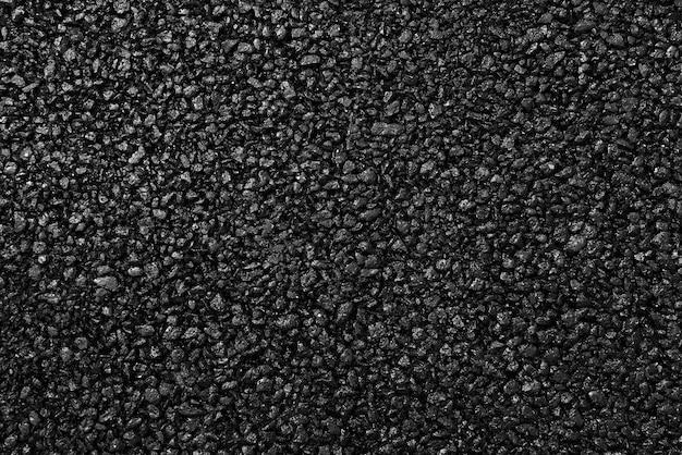 Japanischer asphaltbelag mit einer schönen schwarz-grauen textur und beleuchtet mit einem weichen licht. Premium Fotos