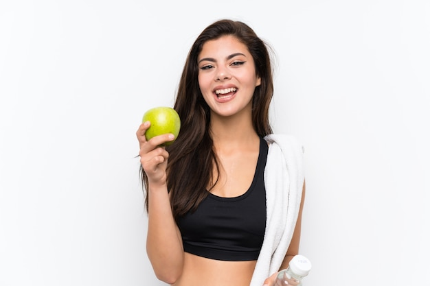 Jugendlichsportmädchen über getrenntem weißem hintergrund mit einem apfel Premium Fotos