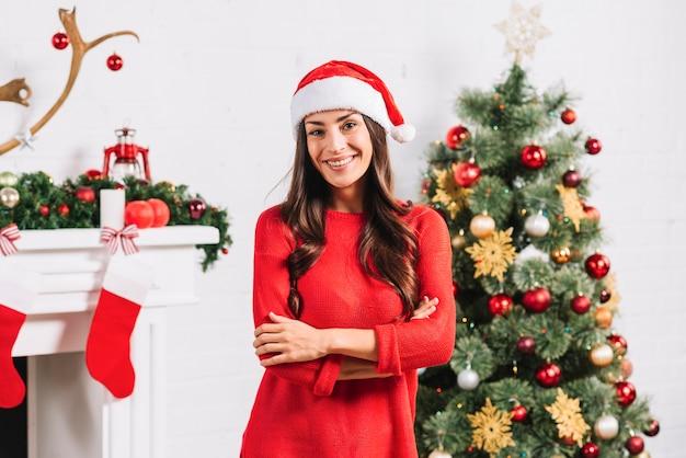 junge dame in der n he von weihnachtsbaum download der. Black Bedroom Furniture Sets. Home Design Ideas