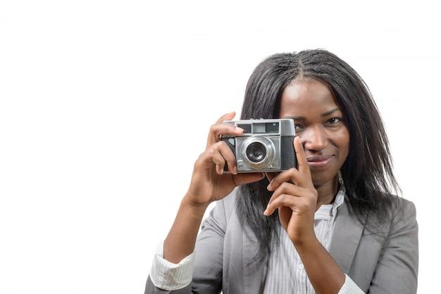 Junge frau mit einer alten kamera Premium Fotos