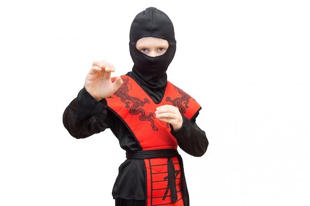 Junge im ninja-anzug Premium Fotos
