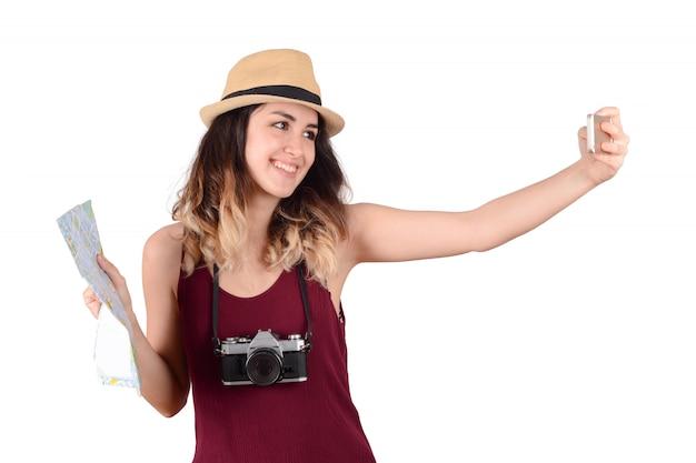 Junge touristische frau, die selfie nimmt. Premium Fotos