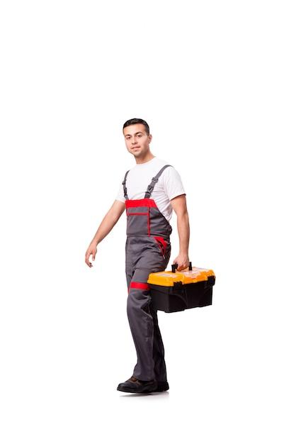 Junger mann mit dem toolkitwerkzeugkasten lokalisiert auf weiß Premium Fotos