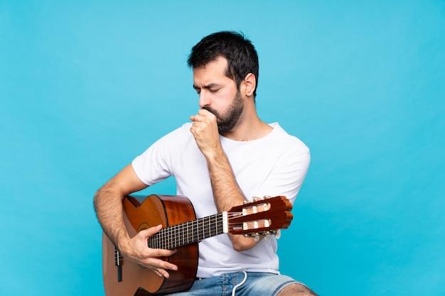 Junger mann mit gitarre Premium Fotos