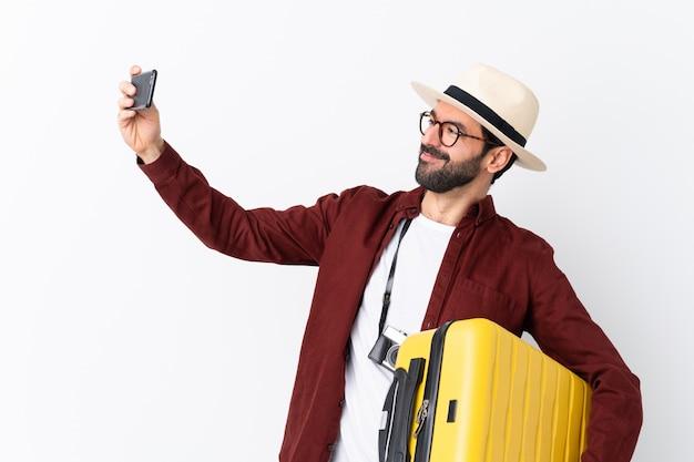 Junger reisender mann Premium Fotos