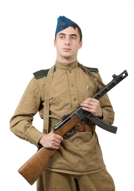 Junger sowjetischer soldat mit maschinengewehr, ww2 Premium Fotos