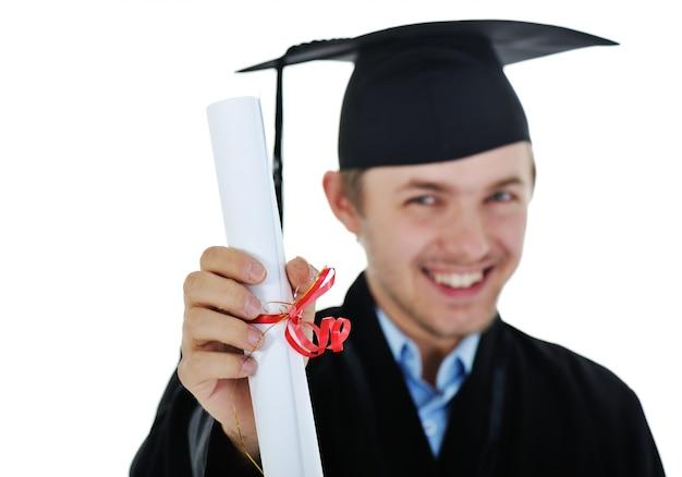 Junger student im aufbaustudium, der ein diplom lokalisiert mit kopienraum hält Premium Fotos