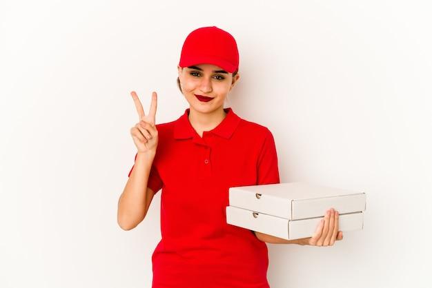 Junges dünnes arabisches pizzabotenmädchen, das fröhlich und zuversichtlich zeigt, ok geste zu zeigen. Premium Fotos