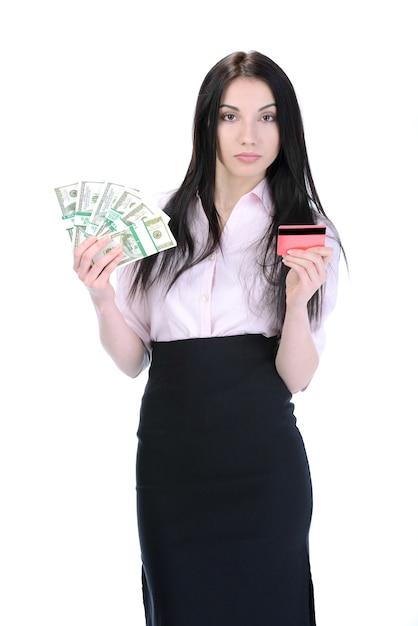 Junges mädchen hält geld und kreditkarte. Premium Fotos