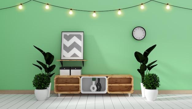 Kabinett-modell auf grüner wand im japanischen wohnzimmer. 3d-rendering Premium Fotos