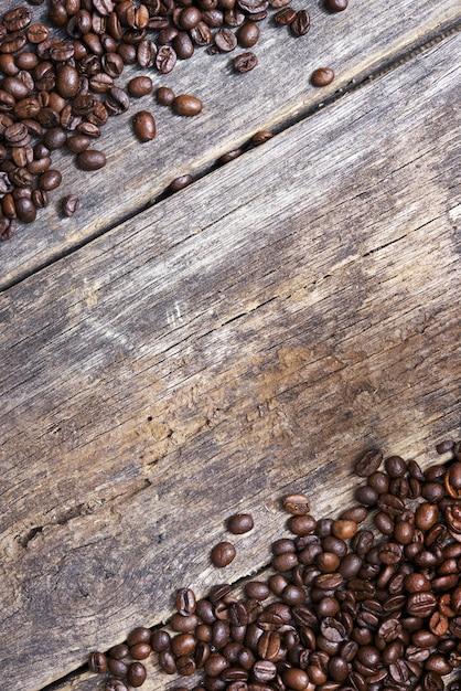 Kaffee hölzerner hintergrund Kostenlose Fotos
