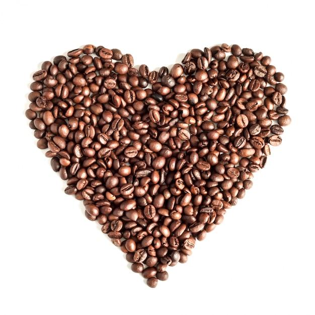 Kaffeebohnen lokalisiert auf draufsicht des weißen hintergrundes Premium Fotos