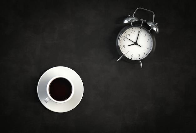 Kaffeetasse mit wecker auf schwarzem hintergrund Premium Fotos