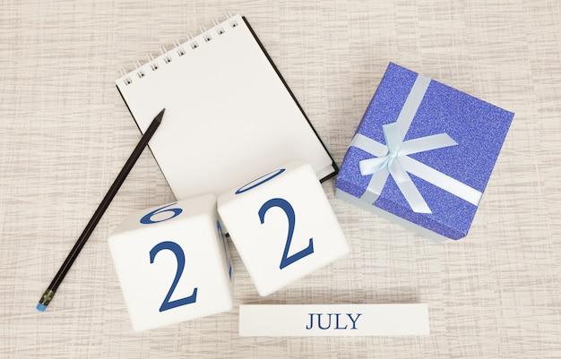 Kalender mit trendigem blauem text und zahlen für den 22. juli Premium Fotos