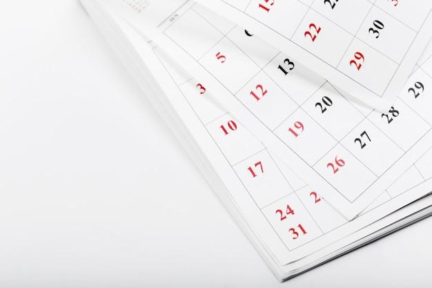 Kalenderseiten schließen herauf geschäftszeit Premium Fotos
