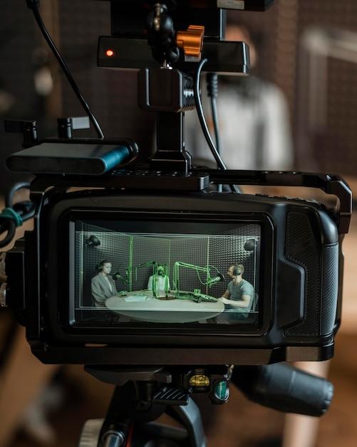 Kamera, die leute im radio filmt Kostenlose Fotos
