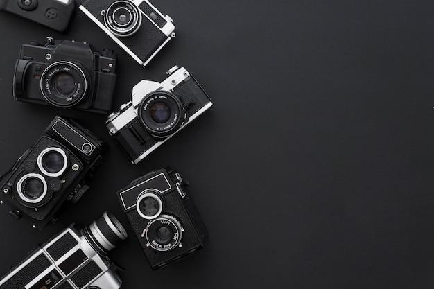 Kameras auf schwarzem hintergrund Kostenlose Fotos