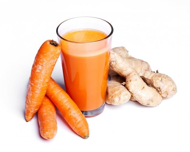 Karottensaft mit ingwerwurzel Kostenlose Fotos