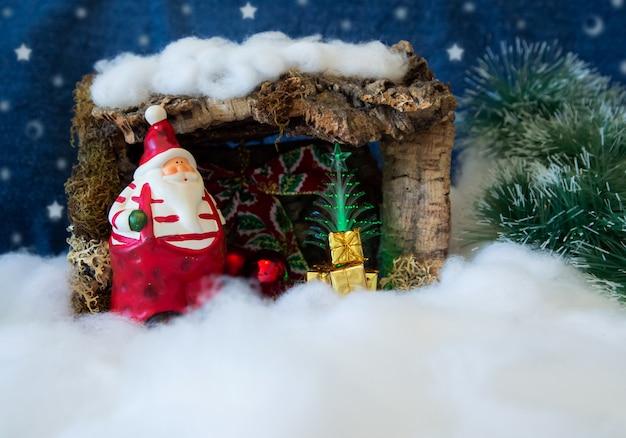 Karte der frohen weihnachten mit abbildung von weihnachtsmann und von schnee Premium Fotos