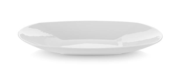 Keramikplatte auf weißer wand Premium Fotos