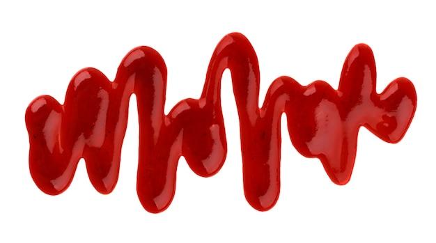 Ketchup. spritzt und verschüttete die ketschupsoße, die auf weiß lokalisiert wird Premium Fotos