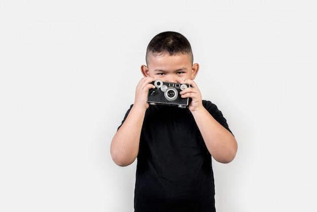 Kid fotograf machen sie ein foto Kostenlose Fotos