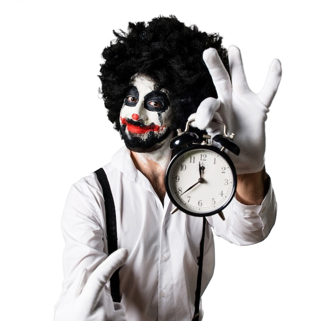 killer clown mit vintage uhr download der kostenlosen fotos. Black Bedroom Furniture Sets. Home Design Ideas