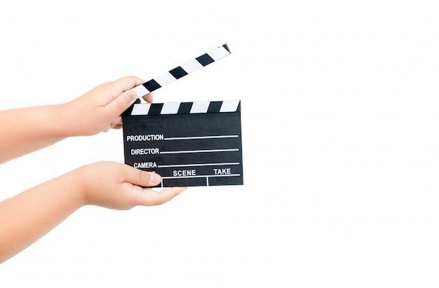Kind, das filmscharnierventil lokalisiert auf weiß hält Premium Fotos