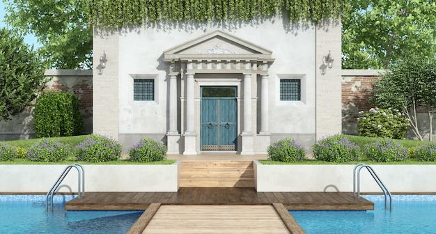 Klassische villa mit luxusgarten mit pool Premium Fotos