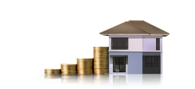 Kleine häuser stehen auf münzstapeln. investitionssparkonzept Premium Fotos