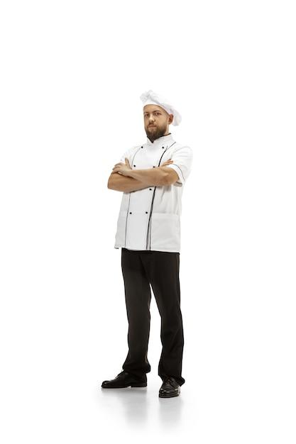 Kocher, koch, bäcker in uniform lokalisiert auf weißem studiohintergrund, gourmet. junger mann, porträt des restaurantkochers. business, foor, beruf, berufskonzept. copyspace für anzeige. Kostenlose Fotos