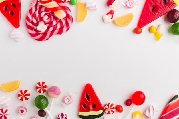 Köstliche bonbons der draufsicht mit kopienraum Kostenlose Fotos