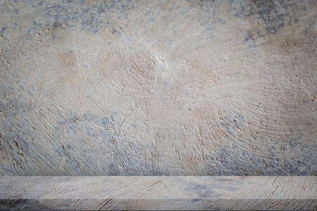 Konkreter boden mit leerem grauem betonmauerhintergrund. Premium Fotos