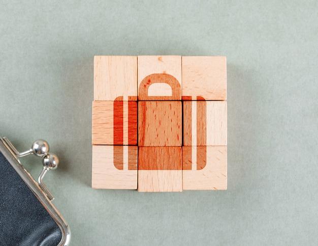 Konzept des geschäfts mit holzklötzen mit aktentasche symbol draufsicht. Kostenlose Fotos