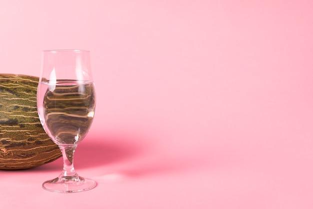 Kopieren sie platz rosa hintergrund mit melone Kostenlose Fotos