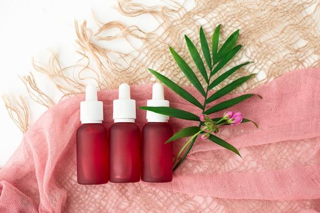Kosmetikflaschen, rosa ölkrüge, Premium Fotos