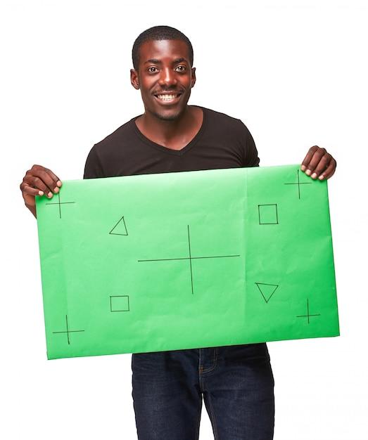 Lächelnder afrikanischer mann als schwarzer geschäftsmann mit grüner tafel Kostenlose Fotos