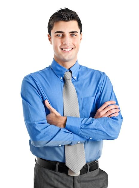 Lächelnder junger geschäftsmann getrennt auf weiß Premium Fotos