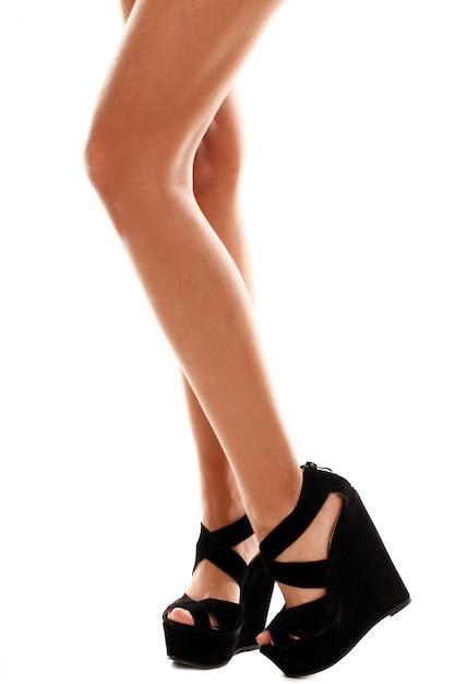 Lange beine mit schwarzen high heels Kostenlose Fotos