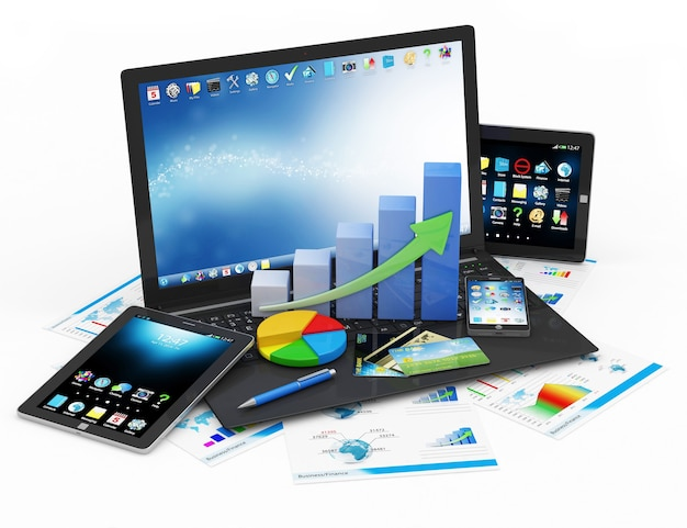 Laptop mit business graph kreisdiagramm und smartphone neben tablet- und finanzberichten Premium Fotos
