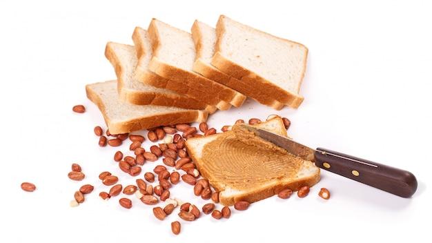 Leckere erdnussbutter auf dem tisch Kostenlose Fotos