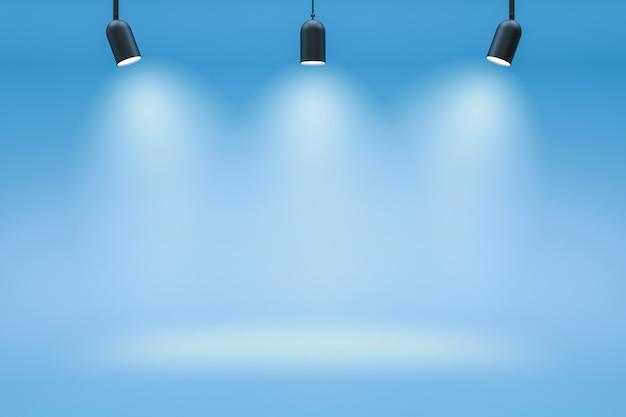 Leere fotostudio-hintergründe und scheinwerfer auf blauem raumhintergrund mit zeigender szene. farbverlauf blau oder leerer raum. 3d-rendering. Premium Fotos