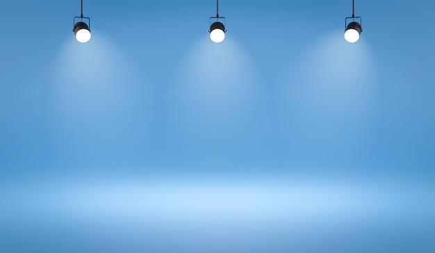Leere fotostudio-hintergründe und scheinwerfer auf blauem raumhintergrund mit zeigender szene. Premium Fotos